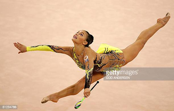Alina Kabaeva of Russia performs the clubs during the individual allround final of the gymnastics rythmic at the Galatsi Olympic hall in Athens 29...