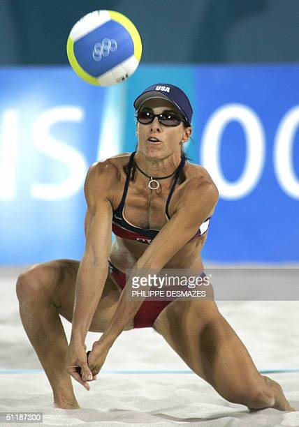 American player Holly McPeack returns the ball during the third round beach volleyball match at the 2004 Olympic Games, in Athens 16 August 2004,...