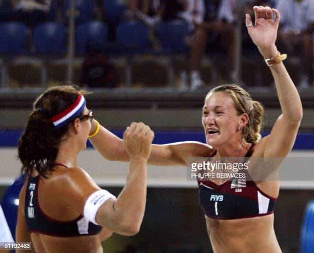 Americans player Kerri Walsh and Misty May celebrate their third round beach volleyball victory over the Czech Republic at the 2004 Olympic Games in...