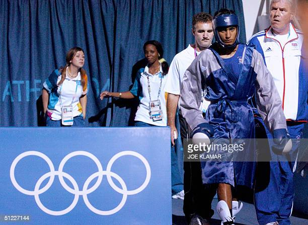 Amir Khan of Great Britain arrives for his lightweight Olympic Games semifinal boxing match against Serik Yeleuov of Kazakhstan at the Peristeri...