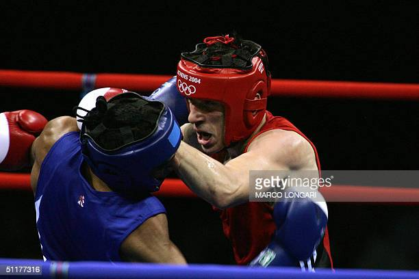 Amir Khan of Great Britain defends against Marios Kaperonis of Greece during their Olympic Games preliminary Lightweight match 16 August 2004 at...