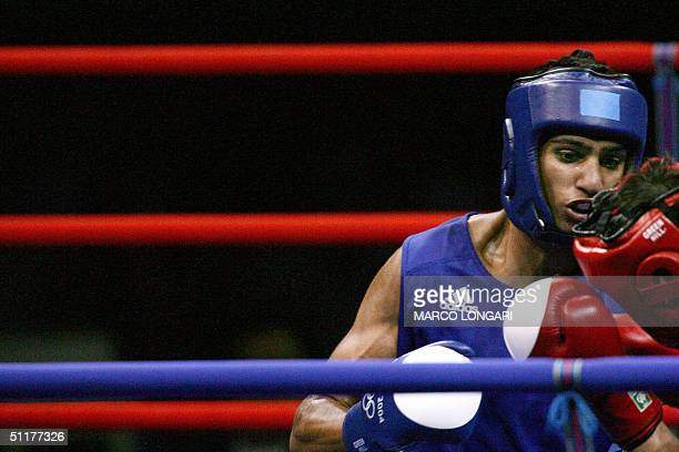 Amir Khan of Great Britain forces Marios Kaperonis of Greece against the ropes during their Olympic Games preliminary Lightweight match 16 August...