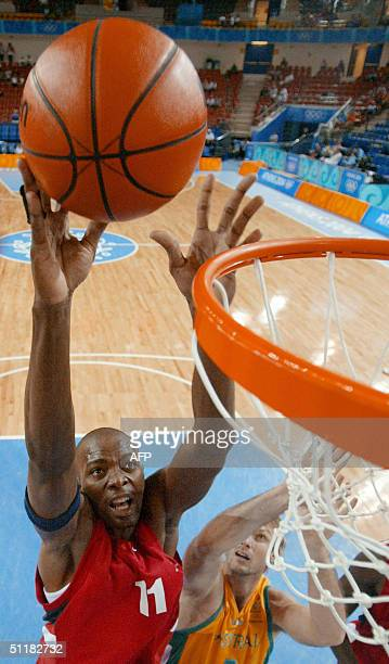 Angola's Victor Muzadi shoots before Australia's Anthony Ronaldson during Olympic Games men's basketball competition 17 August 2004 in Athens AFP...