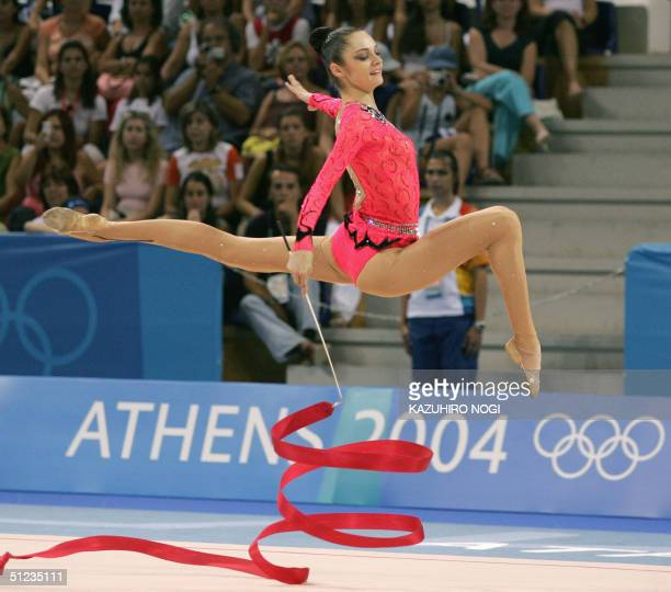 Anna Bessonova of Ukraine performs with a ribbon in the gymnastics rhythmic individual allaround final 29 August 2004 at the Galatsi Olympic Hall...
