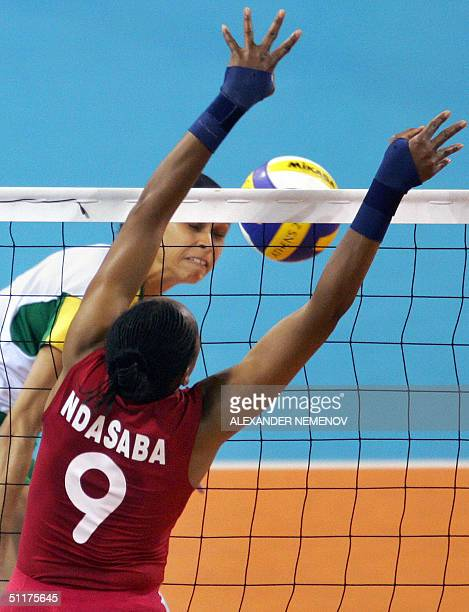 Anna Chagos of Brazil hits a smash as Dorcas Nakhomicha tries to block the shot during their women's volleyball preliminary pool A match at the 2004...