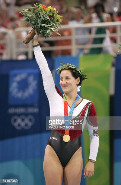 Anna Dogonadze of Germany celebrates her gold medal during the awards ceremony for the women's trampoline final 20 August 2004 at the Olympic Indoor...