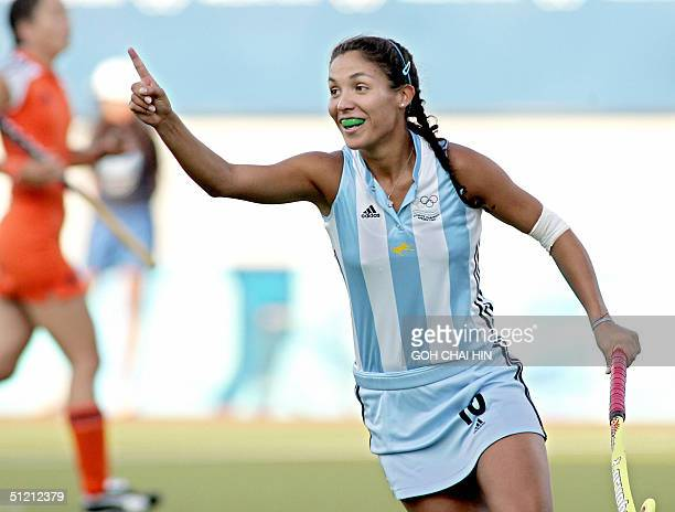 Argentina's Soledad Agustina Garcia jubilates after scoring the team's first goal against Netherlands during first half action in the semifinal match...