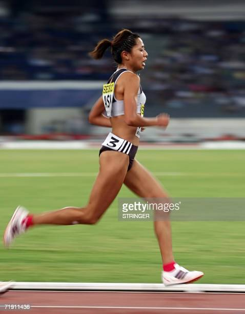 Asia's representative Japanese Kayoko Fukushi performs at the 5000m during the 10th IAAF World Cup at the Athens' Olympic stadium 17 September 2006...