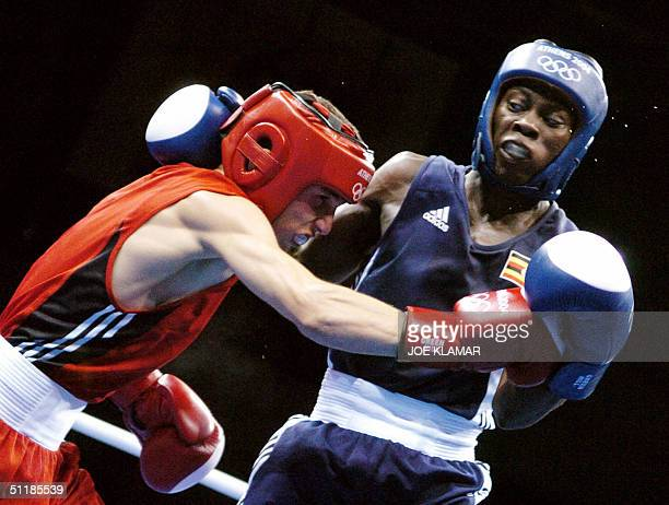Atagun Yalcinkaya of Turkey and Jolly Katongole of Uganda exchange blows during their 2004 Olympic Games preliminary Light Fly match 18 August 2004...