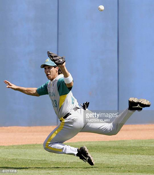Australia leftfielder Paul Gonzalez dives in a vain attempt as catching a double off the bat of a Japanese batter during the third inning of their...