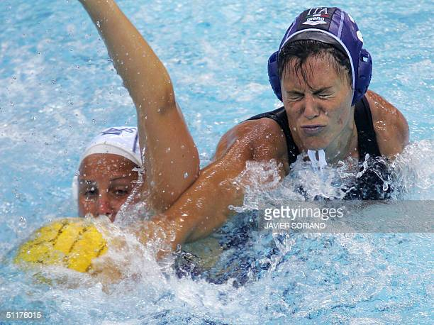 Australian Jodie Stuhmcke fights for the ball with Italian Martina Miceli and Giusy Malato during their Olympic Games women's preliminariy group A...