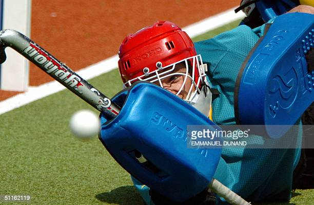 Australian men's hockey team goalkeeper Mark Hickman lets a ball enter his goal during a training session at the 2004 Olympic Games in Athens 12...