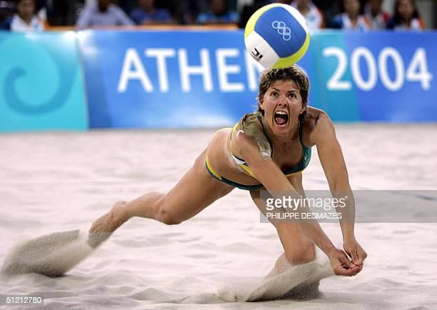 Australian Natalie Cook returns the ball during the women's beach volleyball third place match against US Holly McPeak/Elaine Youngs at the 2004...