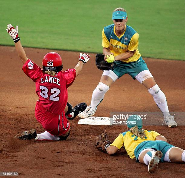Australian shorstop Natalie Ward puts out Canadian Jackie Lance , with the asistance of Fiona Crawford at the third inning of the preliminary round...