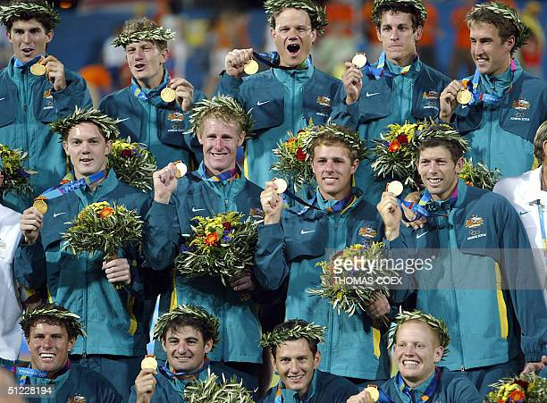 Australia's hockey team poses on the podium with their gold medals after winning the men's Field Hockey final against Netherlands at the 2004 Olympic...