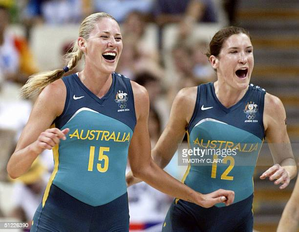 Australia's Lauren Jackson and Belinda Snell celebrate at the end of the women's basketball semifinals match 27 August 2004 at the Olympic Indoor...