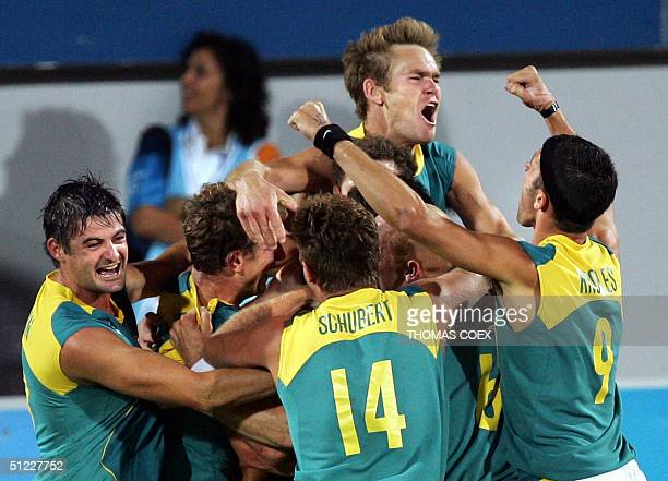 Australia's men Hockey team jubilate after they won the men's Field Hockey gold medal final between Australia and Netherlands at the 2004 Olympic...