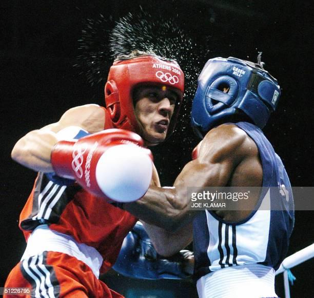 Bahodirjon Sooltonov of Uzbekistan exchanges blows with Guillermo Rigondeaux Ortiz of Cuba during their bantamweight semi-final boxing match of the...