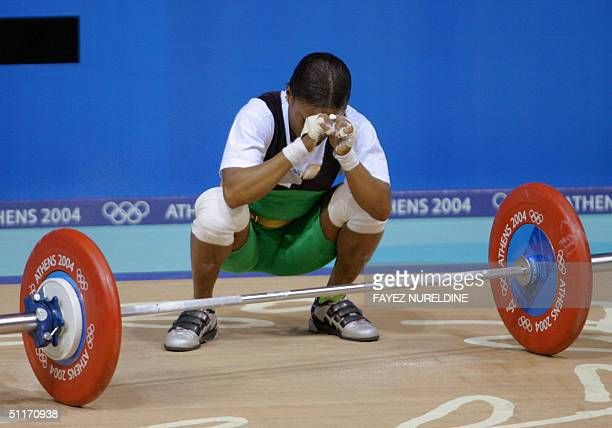 Blessed Udoh of Nigeria reacts after failing an attempt in the 48 kg weightlifting category during the 2004 Olympic Games 14 August 2004 in Athens...