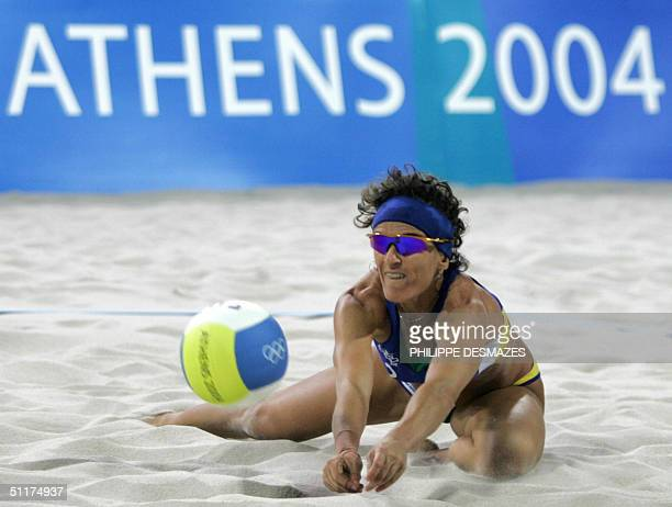 Brazilian player Shelda Bede returns the ball during the first round beach volleyball competition against South Africa at the 2004 Olympic Games in...