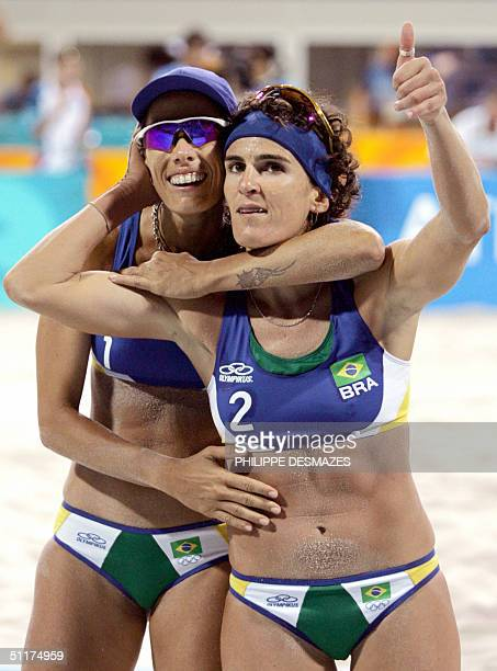 Brazilian players Adriana Behar and Shelda Bede celebrate beating South Africa's Ann Naidoo and Julia Willand in their first round beach volleyball...