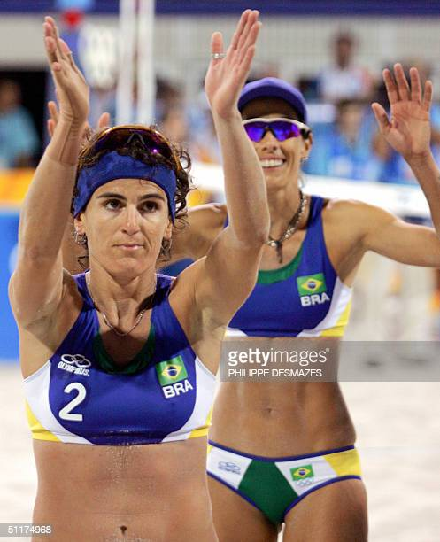 Brazilian players Shelda Bede and Adriana Behar celebrate beating South Africa's Ann Naidoo and Julia Willand in their first round beach volleyball...