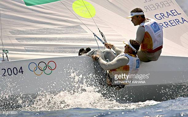 Brazilian sailors Torben Grael and Marcelo Ferreira sail during Men's Keelboat -Star race six place them first 24 August 2004, on the eleventh day of...