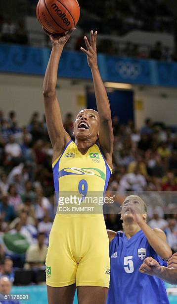Brazil's Janeth Arcain shoots over Greece's Anastasia Kostaki 16 August 2004 during the Olympic Games Women's Basketball preliminaries at Helliniko...