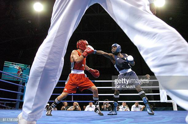 Brian Mayana of Uganda connects a left jab against Galib Jafarov of Kazakhstan during their Olympic Games preliminary 57 kg Featherweight match at...