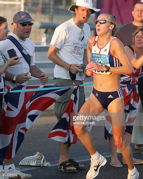 Britain's Paula Radcliffe runs past her fans during the Olympic Games women's Marathon race in Athens, 22 August 2004. But it was a disastrous day...