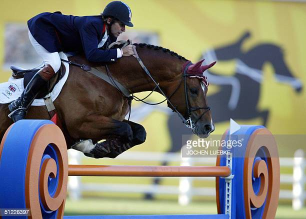 "British jumping rider Nick Skelton clears a fence on his horse ""Arko III"" 27 August 2004 at the Markopoulo Olympic Equestrian Centre in Athens during..."