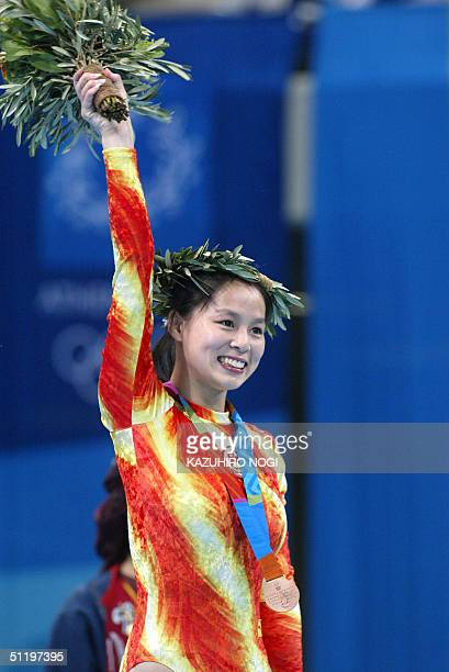 Bronze medallist Hung Shanshan of China celebrates during the awards ceremony 20 August 2004 at the Olympic Indoor Hall during the Athens 2004...