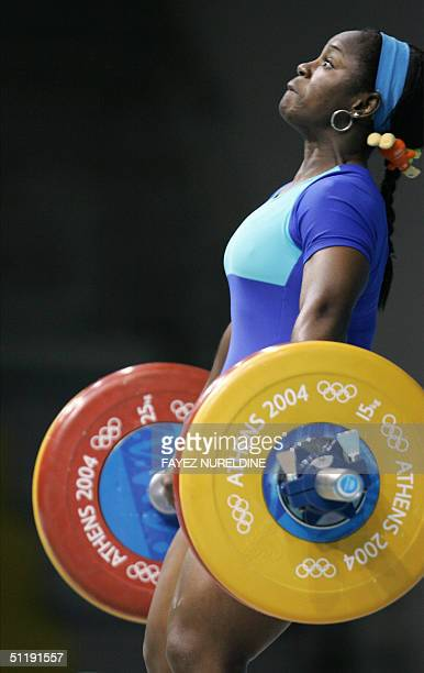 Cameroon's Madeleine Yamechi performs a lift during the women's 69kg weighlifting competition at the Olympic Games at the 2004 Olympic Games in...