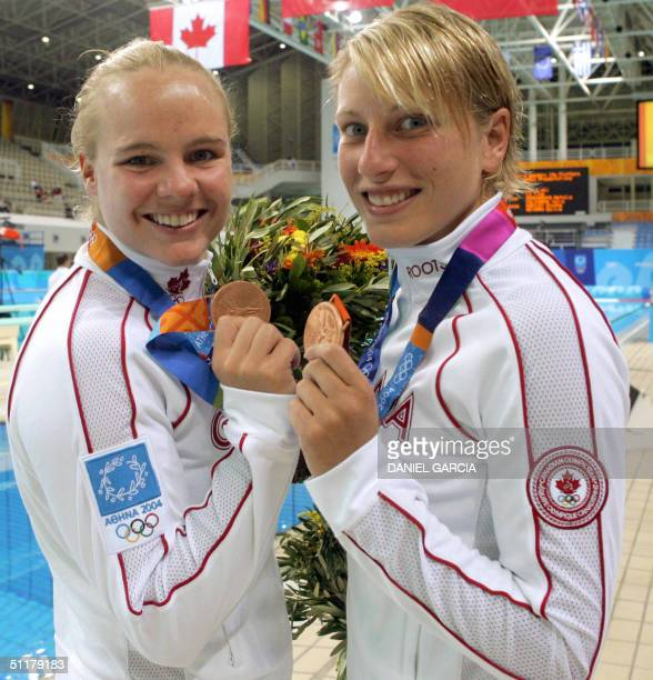 Canada's Blythe Hartkey and Emilie Heymans show their bronze medals in the women's synchronised 10m platform final 16 August 2004 at the Olympic...