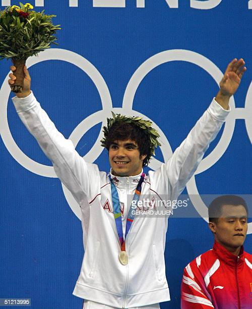 Canadian Alexandre Despatie pose on the podium after winning the men's 3m springboard silver medal at the Olympic aquatic center at the 2004 Olympic...