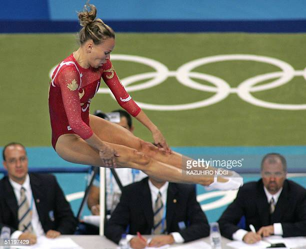 Canadian Karen Cockburn performs in the air during the women's trampoline final 20 August 2004 at the Olympic Indoor Hall during the Athens 2004...