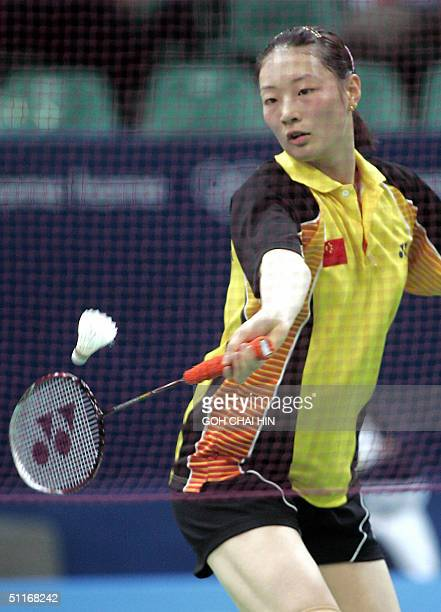 China's Gong Ruina competes against Singapore's Li Li, in the women's single first round of the Olympic Games badminton competition, at the Goudi...