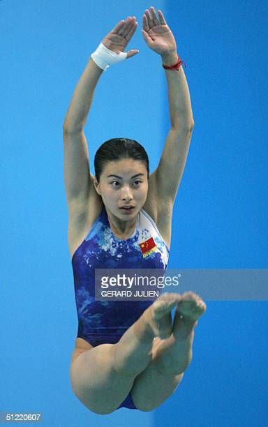 Chinese Guo Jungjing dives during the women's 3m springboard semifinal at the Olympic aquatic center at the 2004 Olympic Games 26 August 2004 in...