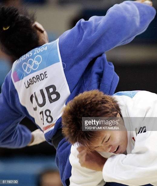 Chinese judoka Liu Xia pushes Yurisel Laborde of Cuba celerbates her ippon win in the quarter final match of women's judo under 78kgs category of the...