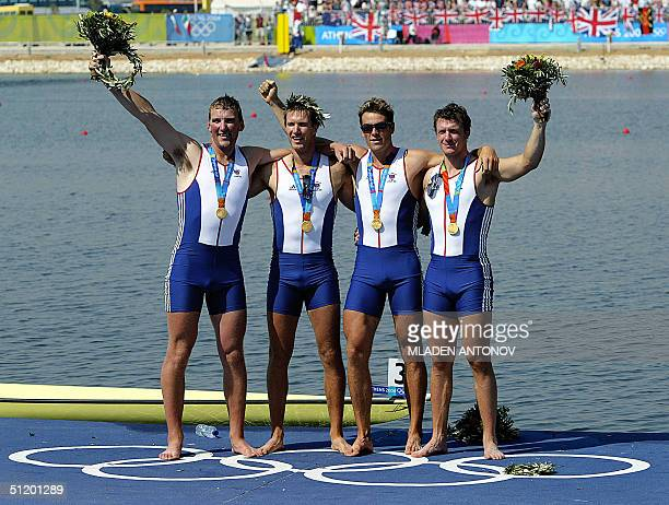 CORRECTIONORDER Britons Steve Williams James Cracknell Ed Coode and Matthew Pinsent celebrate on the podium after receiving their gold medals in the...