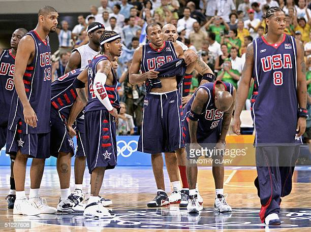 Dejected American team players walk off the court after loosing to Argentina 8789 during their Olympic Games men's basketball semi final match 27...