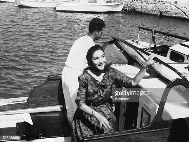Denies Romance Opera Singer Maria Callas smiles for photographers aboard launch from the Christina yacht belonging to Greek shipping magnate...