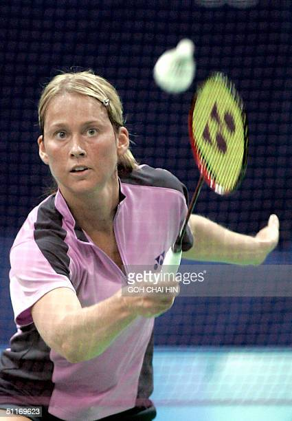 Denmark's Camilla Martin returns a shot against Japan's Kaneko Yonekura in the women's first round of the Olympic Games badminton competition, at the...