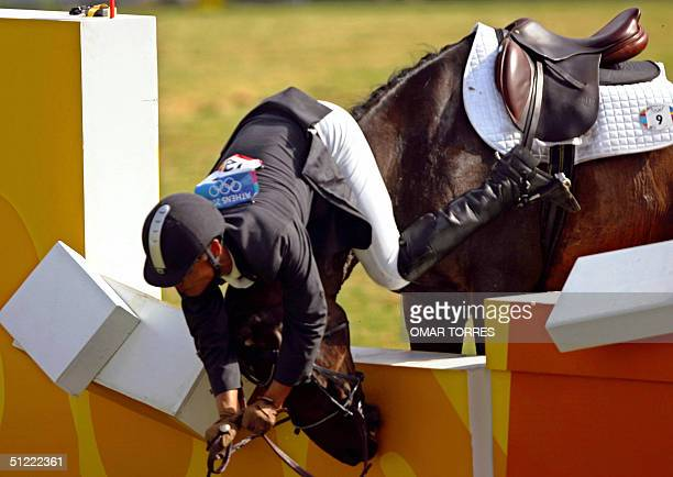 "Do Ryung Han of Korea falls down from his horse ""Bario"", after the animal refuses to jump one of the obstacules at the Riding discipline of Modern..."
