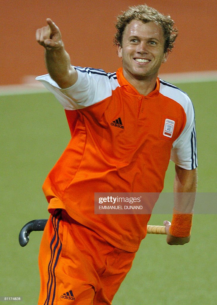 Dutch hockey player Teun De Nooijer celebrates after scoring his team's second goal against India during their match in the first round of the men's hockey competition at the 2004 Olympic Games in Athens, 15 August 2004. Netherlands won India 3-1.