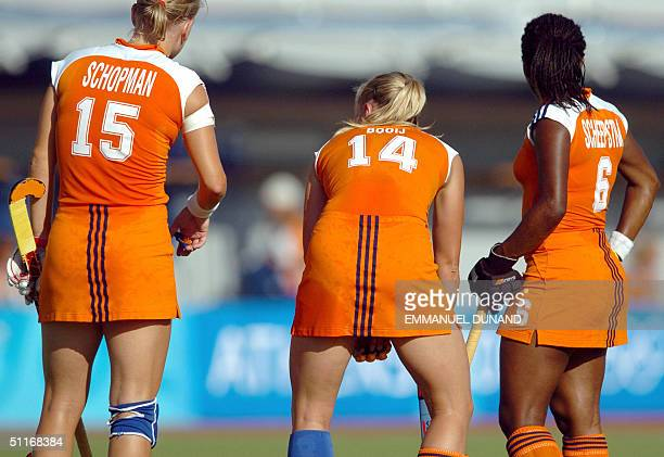 Dutch hockey players Janneke Schopman Minke Booij and Maartje Scheepstra devise which strategy to use to hit a penalty corner against South Africa...