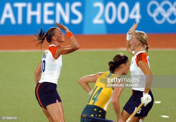 Dutch hockey team captain Mijntje Donners and teammate Janneke Schopman celebrate after Donners scored a goal against Autralia while Australia's...