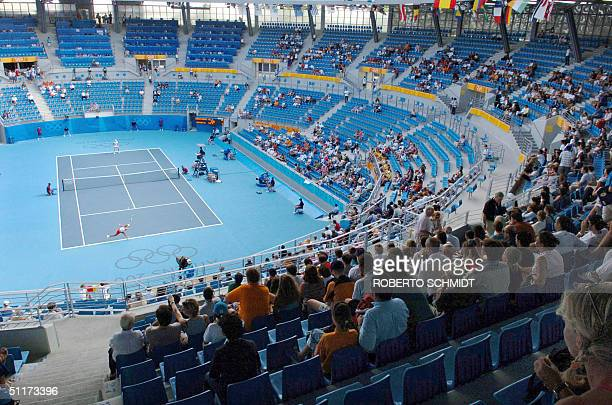 Empty seats are abound as only a small handful of spectators attend the tennis event at the Olympic Tennis Centre in Athens 15 August 2004 on the...