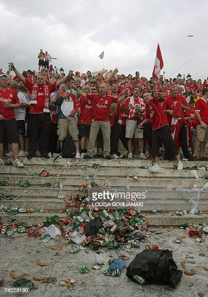 Facing heaps of empty bottles and waste Liverpool fans most of them without tickets cheer in central Athens few hours prior to the kick off of the...