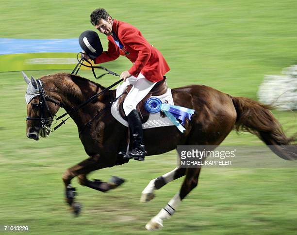 """German jumping rider Ludger Beerbaum rides on his horse """"Goldfever"""" 24 August 2004 at the Markopoulo Olympic Equestrian Centre in Ahtens after the..."""